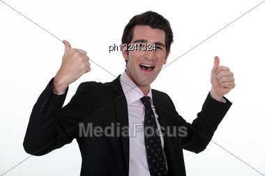 Portrait Of A Businessman Rejoicing Stock Photo