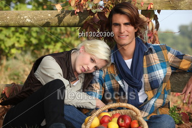 Portrait Of A Couple Outdoors Stock Photo
