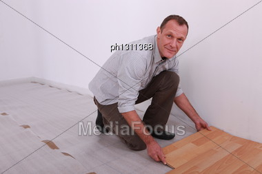 Portrait Of A Man Laying Parquet Stock Photo