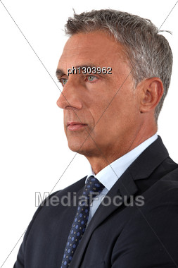 Portrait Of A Serious Businessman Stock Photo