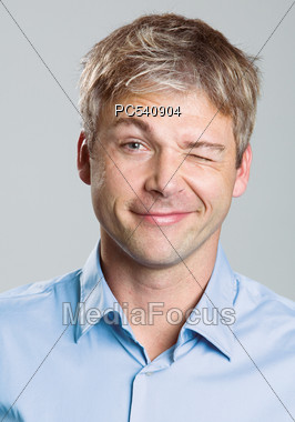 Portrait Of Adult Male Winking Stock Photo