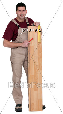Portrait Of Carpenter Laying Parquet Stock Photo