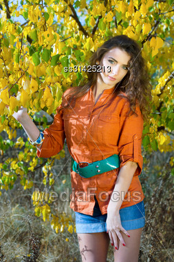 Portrait Of A Cute Young Woman Outdoors Stock Photo