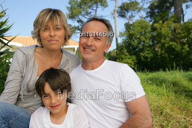 Portrait Of A Family In Their Garden Stock Photo