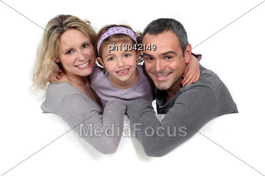 Portrait Of A Family Sitting On A Sofa Stock Photo