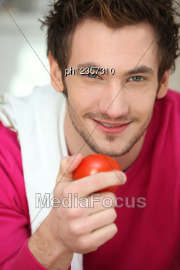 Portrait Of A Man Holding A Tomato Stock Photo