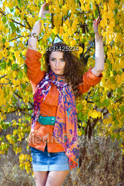 Portrait Of A Pretty Young Woman Outdoors Stock Photo
