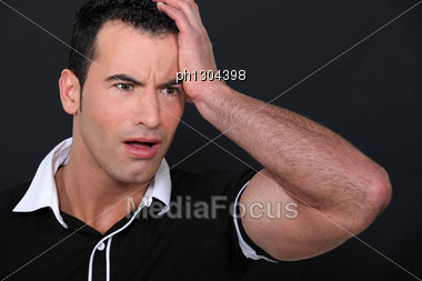 Portrait Of Scared Man Stock Photo