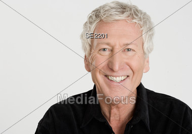 Portrait Of Senior Man Smiling Stock Photo