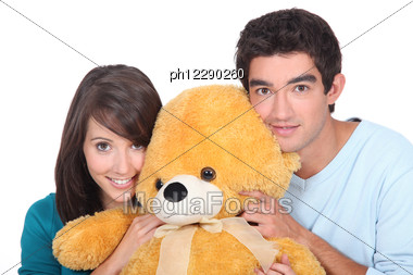 Portrait Of Teenagers With Teddy-bear Stock Photo