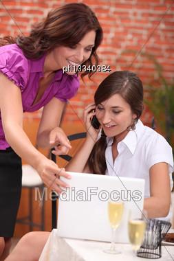 Portrait Of Two Businesswomen At Restaurant Stock Photo