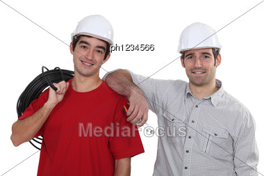Portrait Of Two Electricians Stock Photo