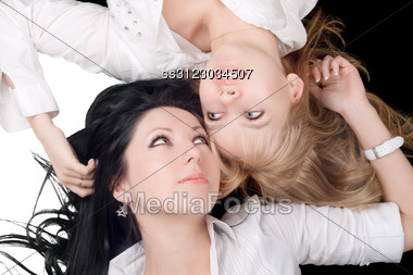 Portrait Of The Two Lying Lovely Girls Stock Photo