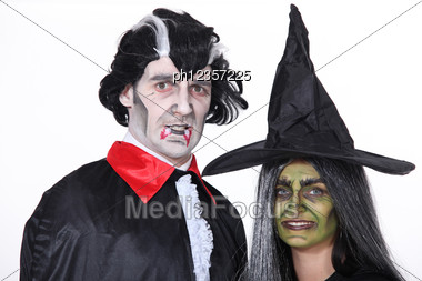 Portrait Of Witch And Vampire Stock Photo