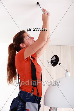 Portrait Of A Woman Doing Electricity Work Stock Photo