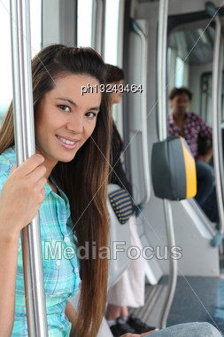 Portrait Of A Woman In Public Transportation Stock Photo
