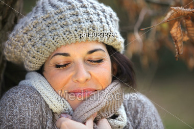 Portrait Of A Woman With Wool Cap Stock Photo
