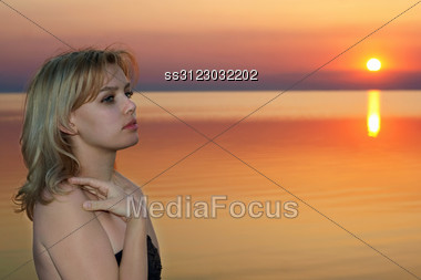 Portrait Of A Young Blonde At Sunset Stock Photo