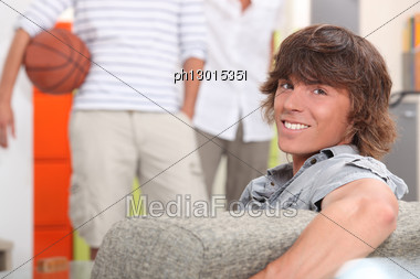 Portrait Of A Young Man On Couch Stock Photo