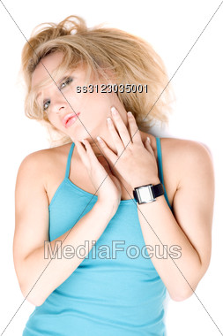 Portrait Of Playful Blond Girl Lying On A White Stock Photo