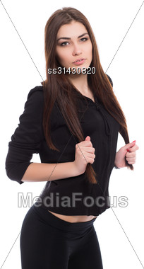 Portrait Of Playful Brunette Wearing Black Clothes. Isolated On White Stock Photo