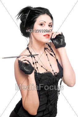 Portrait Of A Playful Young Brunette With Cigarette Holder Stock Photo