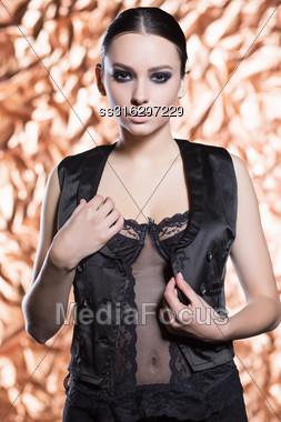 Portrait Of Pretty Brunette Posing In Black Vest Stock Photo