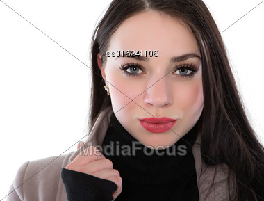 Portrait Of Pretty Brunette Wearing Coat And Sweater. Isolated On White Stock Photo