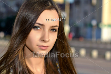 Portrait Of Pretty Thoughtful Caucasian Lady Posing Outdoors Stock Photo