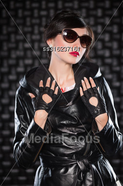 Portrait Of Pretty Woman Posing In Black Jacket And Sunglasses Stock Photo