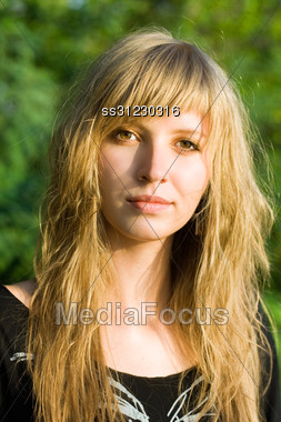 Portrait Of Pretty Young Blond Woman Outdoors Stock Photo