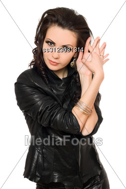 Portrait Of Pretty Young Brunette In Black Clothes. Stock Photo