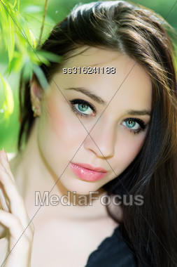 Portrait Of Pretty Young Brunette Posing Outdoors Stock Photo