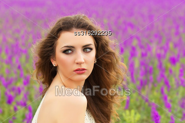 Portrait Of Pretty Young Brunette Showing Her Bare Shoulder Stock Photo