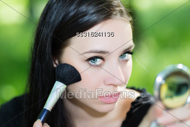 Portrait Of Pretty Young Lady Doing Makeup Stock Photo