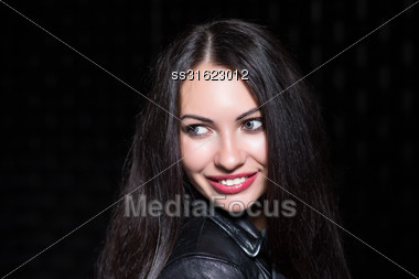 Portrait Of Pretty Young Smiling Brunette. Isolated On Black Stock Photo