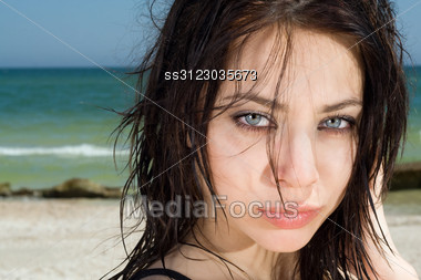 Portrait Of The Pretty Young Woman On A Beach Stock Photo