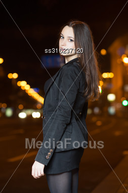 Portrait Of Pretty Young Woman Posing In The Evening Stock Photo