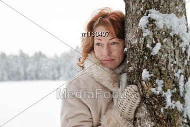 Portrait Of Red-haired Woman In Winters Day Stock Photo
