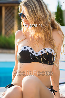 Portrait Of Sexy Blond Woman Near The Pool Stock Photo