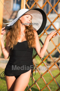 Portrait Of Sexy Blond Woman Wearing Posing Outdoor Stock Photo