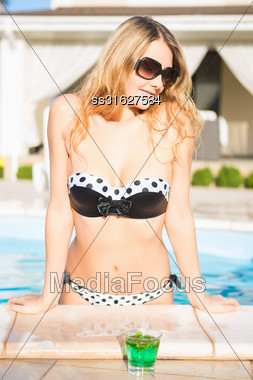Portrait Of Sexy Blonde Posing In The Swimming Pool Stock Photo