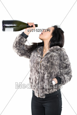 Portrait Of Sexy Brunette Wearing Furry Jacket With A Big Bottle. Isolated On White Stock Photo