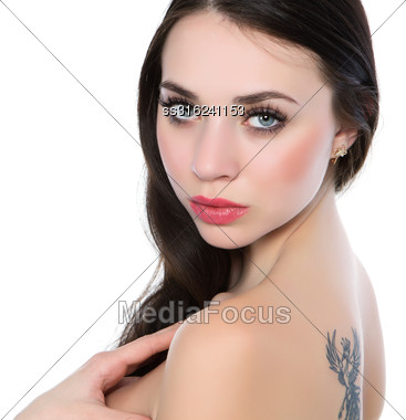Portrait Of Sexy Naked Brunette With A Firebird Tattoo. Isolated On White Stock Photo