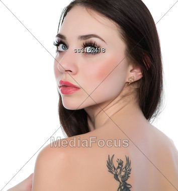 Portrait Of Sexy Naked Woman With A Tattoo. Isolated On White Stock Photo