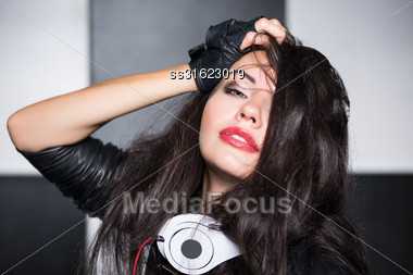 Portrait Of Sexy Playful Woman Posing In The Studio Stock Photo