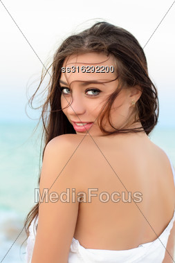 Portrait Of Sexy Smiling Young Brunette Posing Outdoors Stock Photo
