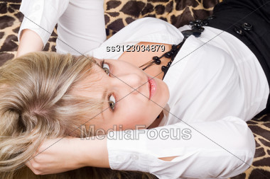 Portrait Of The Sexy Young Beauty Blonde Lies On A Bed Stock Photo