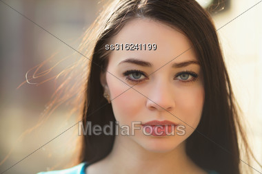 Portrait Of Sexy Young Brunette Posing Outdoors Stock Photo