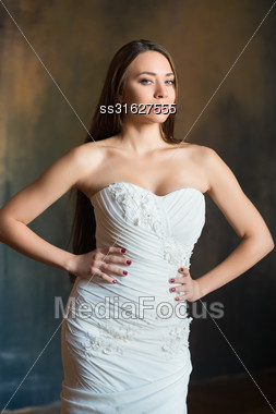 Portrait Of Sexy Young Woman Posing In Wedding Dress Stock Photo